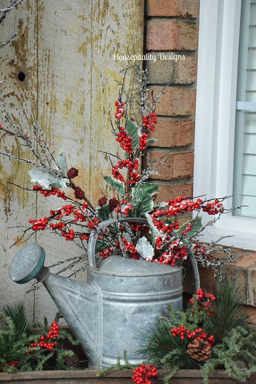 lets go rustic this christmas if you have an old watering can lying around you can use that to decorate and create a dreamy setting in your porch - Rustic Outdoor Christmas Decorations