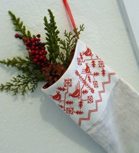 Embroidered Christmas stockings are another way of adding some spark into your plain stockings. Photo Credit: http://1.bp.blogspot.com/-Gn5wBnbkW34/UIxn1pUMxjI/AAAAAAAAAWo/vjR9CIVJJ5Y/s1600/stockingredworkbirdlargecuff1000pxwide.jpg