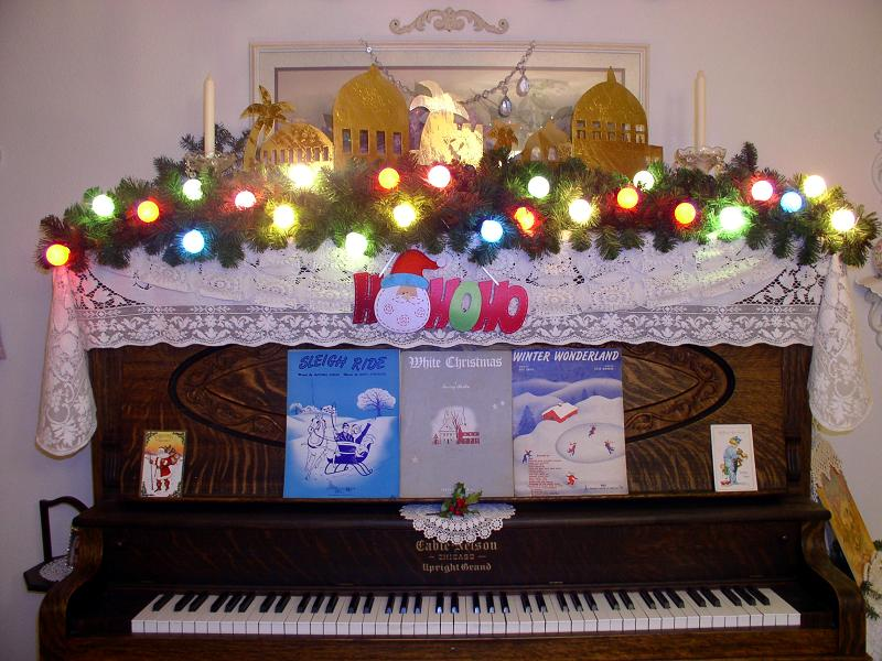 christmas decorations on piano