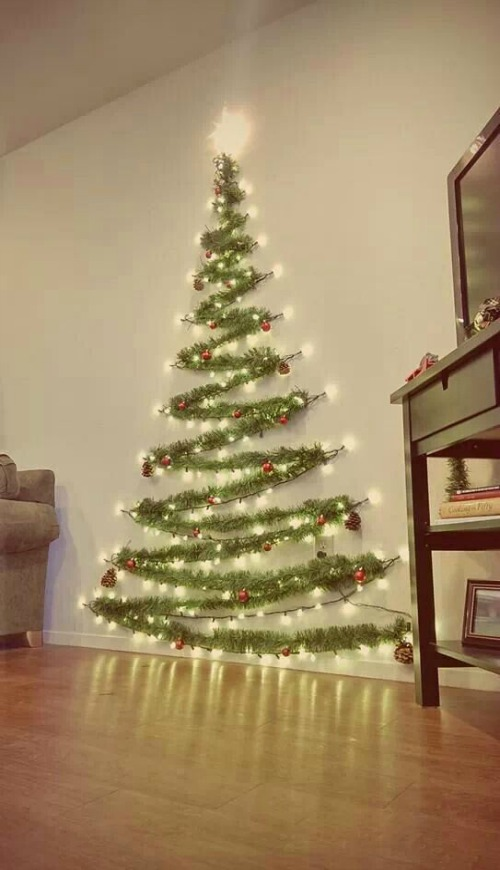no room or space for a christmas tree worry not you can have your own tree a lighted one on your wall like above christmas decoration idea - Indoor Decorative Christmas Trees