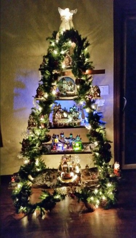 There Are So Many Ways To Display A Snow Village And One Creative Way Is  Using A Ladder. Join Two Ladders And Wrap Them With Garland And Lights.