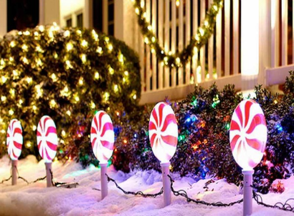 the peppermint decorations simply add a pop of color to the front of your yard these sweet christmas candy shaped lamps will surely give a smile to the