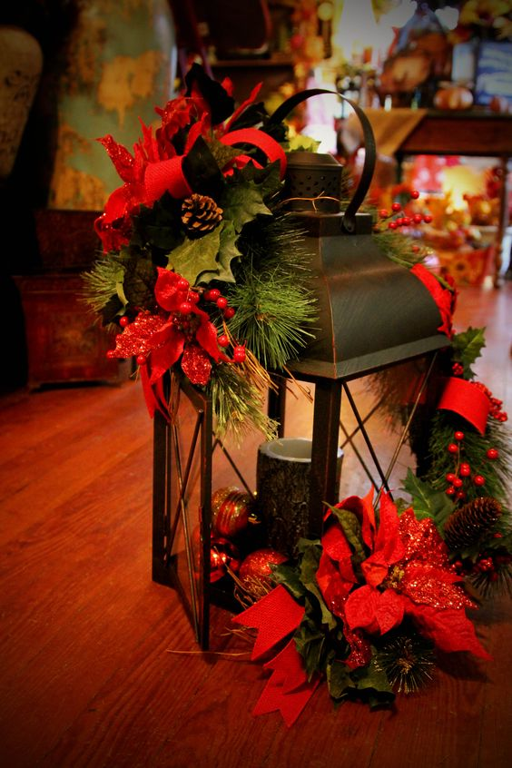 indoor christmas lantern with poinsettia