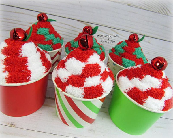 this is pretty easy to do all you need are colorful cups christmas themed socks and ornament swirl and put the socks inside the cup