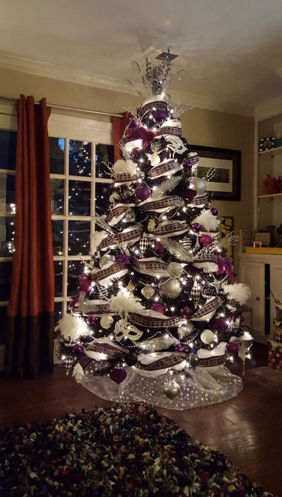 a white christmas tree decorated with purple black and silver deco mesh and ornaments to make it more dreamy a beautiful christmas light was added - Black And Silver Christmas Tree