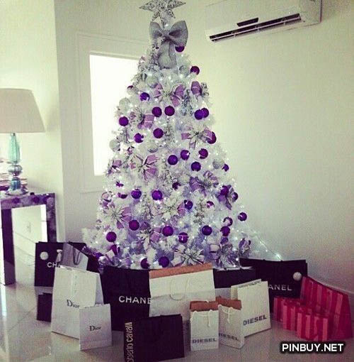 you can simply decorate your white christmas tree with solid colored christmas balls add some purple and silver ribbons