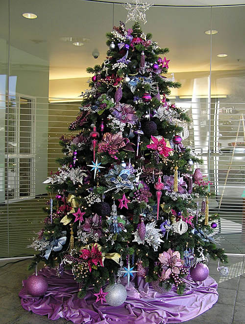 Green Christmas Tree With Beautiful Purple Ornaments