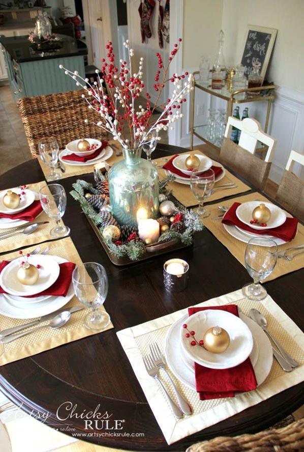 make your table sparkle with simple christmas setting just a simple but elegant centerpiece made of pine cones twigs and candle