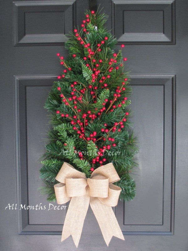 red holly berry christmas wreath with burlap bow source - Red Berry Christmas Tree Decorations