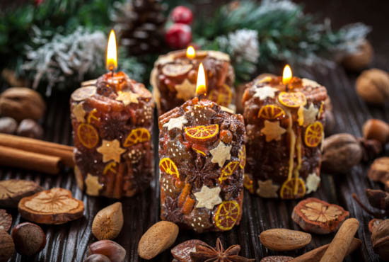Rustic Christmas candles with spices and nuts