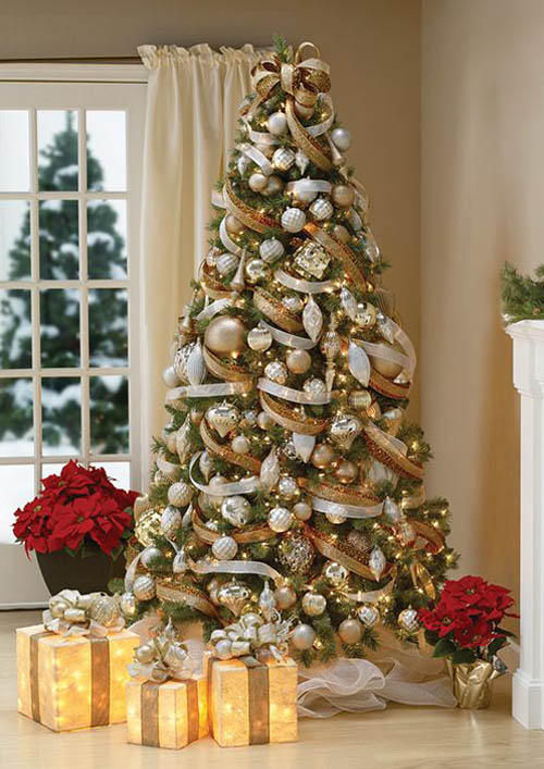 gold white and brown ribbons are tied together and wrap the christmas tree the gold and silver ornaments beautify the