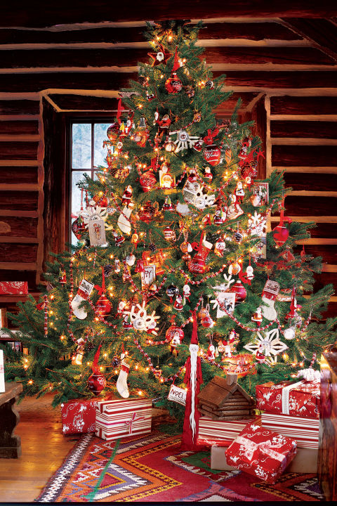 this christmas tree is quite festive with its bright red ornaments that goes along well with white decorations snowflakes and stockings
