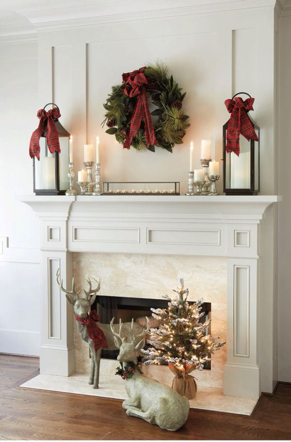 1 reindeers guarding the mantle - How To Decorate A Fireplace Mantel For Christmas