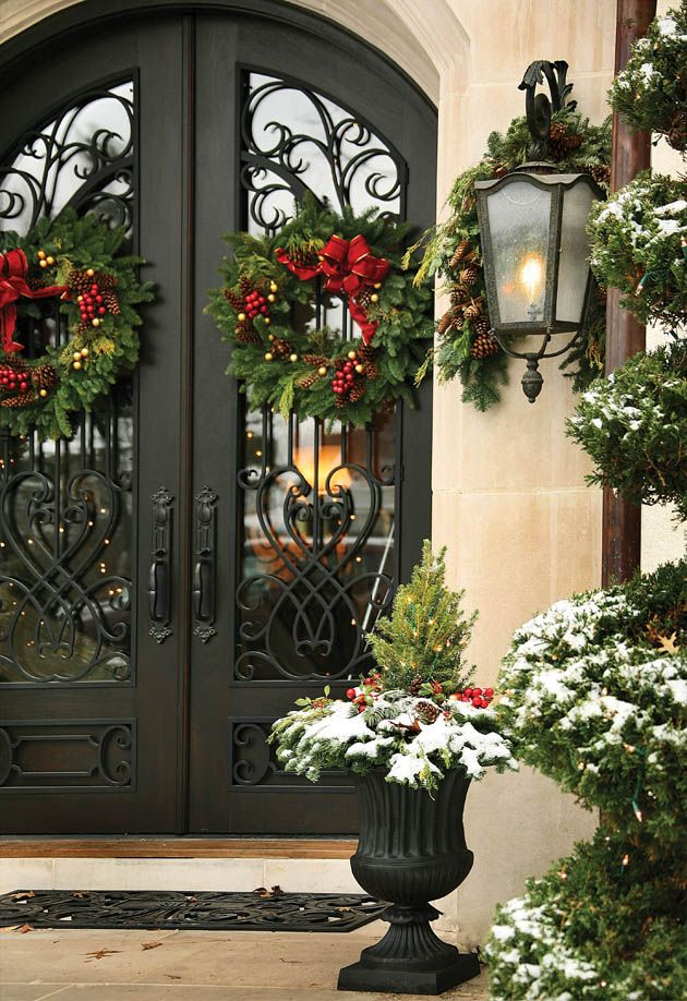 front black door decorated with greens wreath source - Front Door Entrance Christmas Decoration