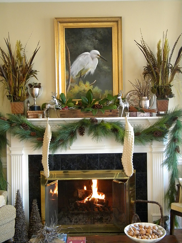Mantelpiece Decorated With Pine Leaves: Source - Top Christmas Mantel Decorations - Christmas Celebration - All About