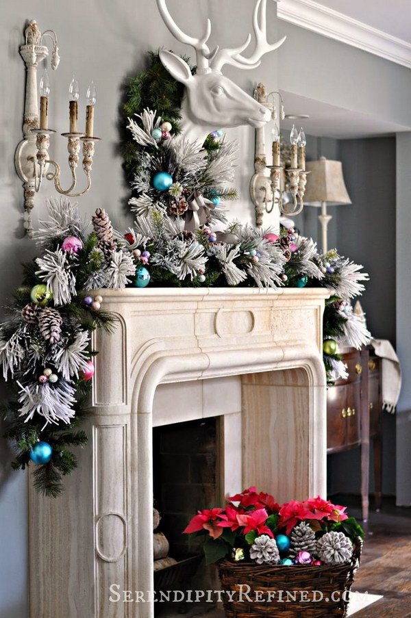painting the animal head trophy white and placing a simple garland of green around its neck gives a surprising and lovely twist to the mantel dcor - Images Of Christmas Decorated Mantels