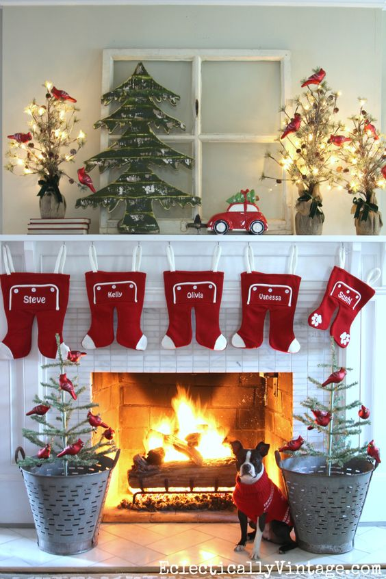 the white mantel provides the best background for the pops of red color the hanging wash pyjama bottom idea is innovative amazing and easy to do