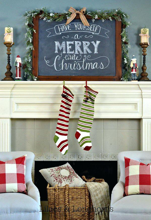 all you need to do is to wrap a garland around a chalkboard mount in on the mantel and youre done simple enough but the amazing look it gives to the