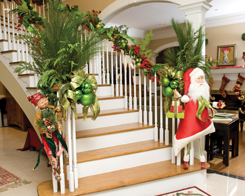 Source Source. This festive staircase is decorated ...