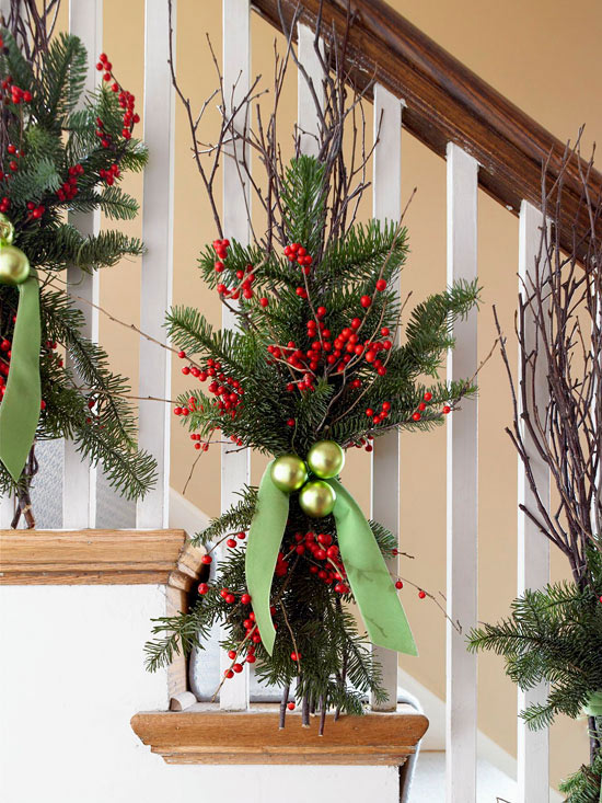 try these greenery bunches here natural birch branches are used but other branches would work equally well matte or glossy ornaments will add a pop - Christmas Decorations For Stair Rail