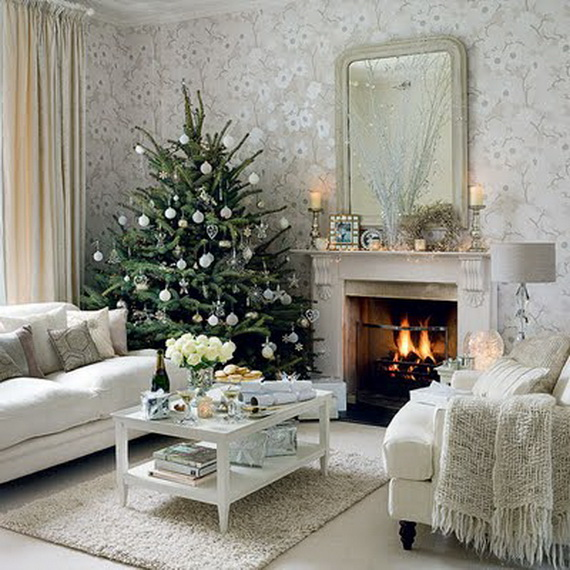metallic ornaments on an all white tree create a spectacular play on light during the daytime it gives a sparkling effect and at night it casts a warm