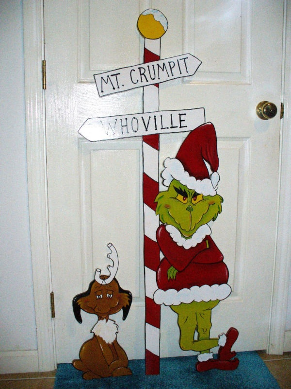a funny christmas door decoration can never go wrong with grinch cut outs and designs what do you say