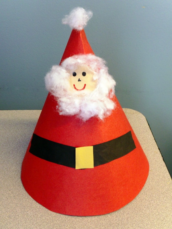 cut a semi circle from red craft paper to make the cap use some wool to make santas face on it this one is simple enough for the young revelers of your