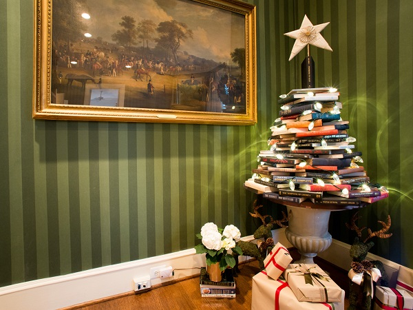 As seen on HGTV's White House Christmas 2013, books are stacked in the shape of a Christmas tree in the Library of the Vice President's home. A repurposed star, made out of the pages of old books, is held up by the book Promises To Keep, written by Vice President Joe Biden, and beneath it is a book by Dr. Jill Biden, Don't Forget, God Bless Our Troops.