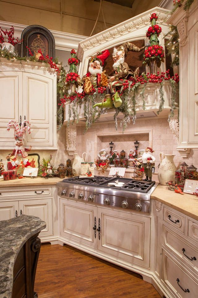 heres such a whimsical way of decorating the kitchen we absolutely loved the placement of elves and santa figures in the kitchen cabinet