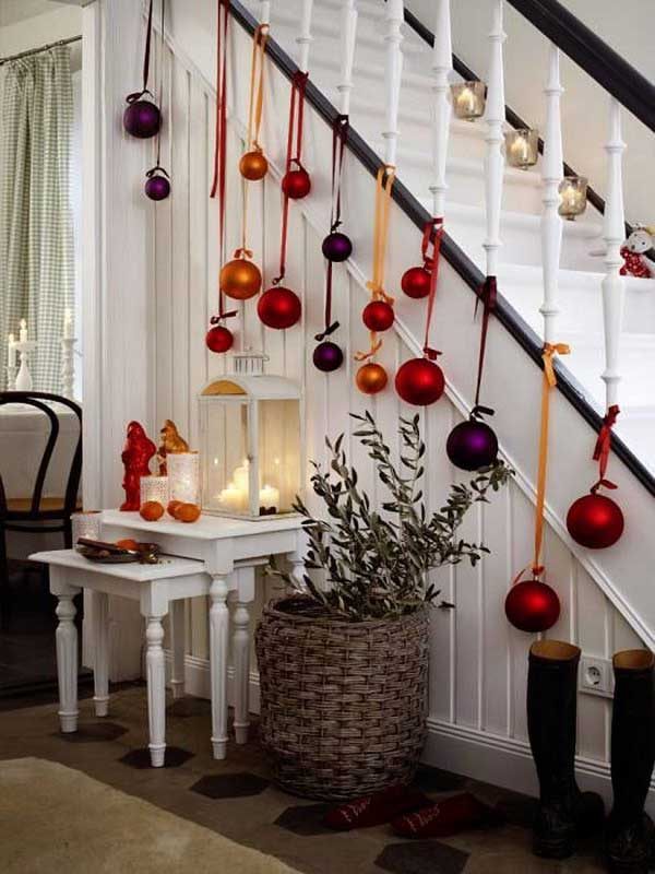 decorate your stairs with the colorful baubles for a festive touch to your christmas decor
