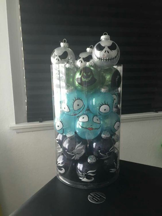 heres another easy to make nightmare before christmas inspired glass centerpiece instead of having those jack and sally ornament in a christmas tree
