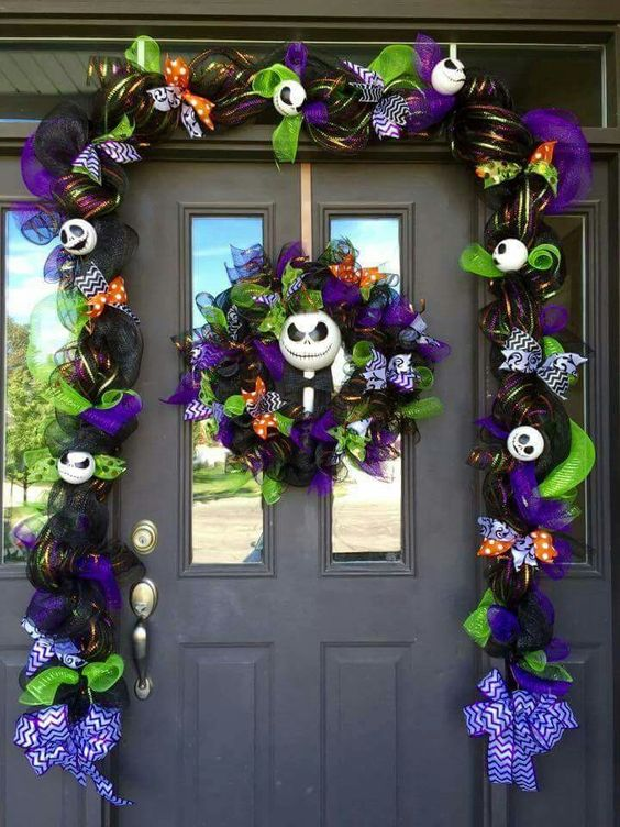 christmas inspired door decoration the arch is decorated with purple black and green mesh ribbons to add the elements of the movie jack skellington - Jack Skeleton Christmas Decorations
