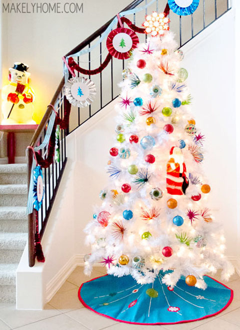 decorating a white christmas tree can be both easy and tricky while you can pretty much put different colors on it since its plain white arranging them
