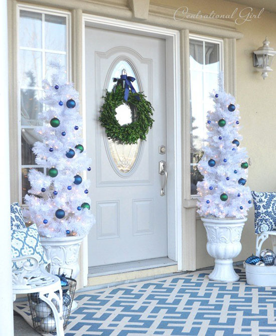 A totally white christmas tree in a white vase, decorated with blue and teal christmas balls, this outdoor white christmas tree decoration ...
