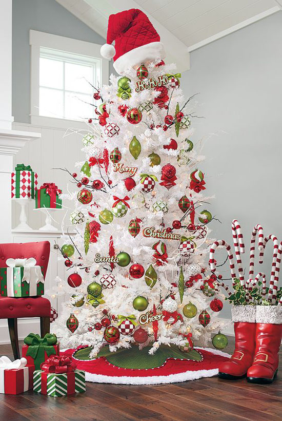 heres a cute santa themed white christmas tree topped with a vibrant red santa hat and decorate with red and green ornaments this white christmas tree