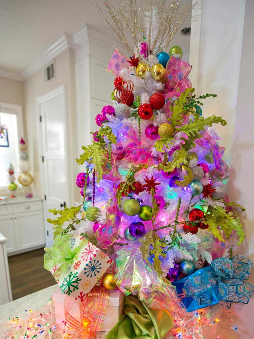 white tree and colorful ornaments source