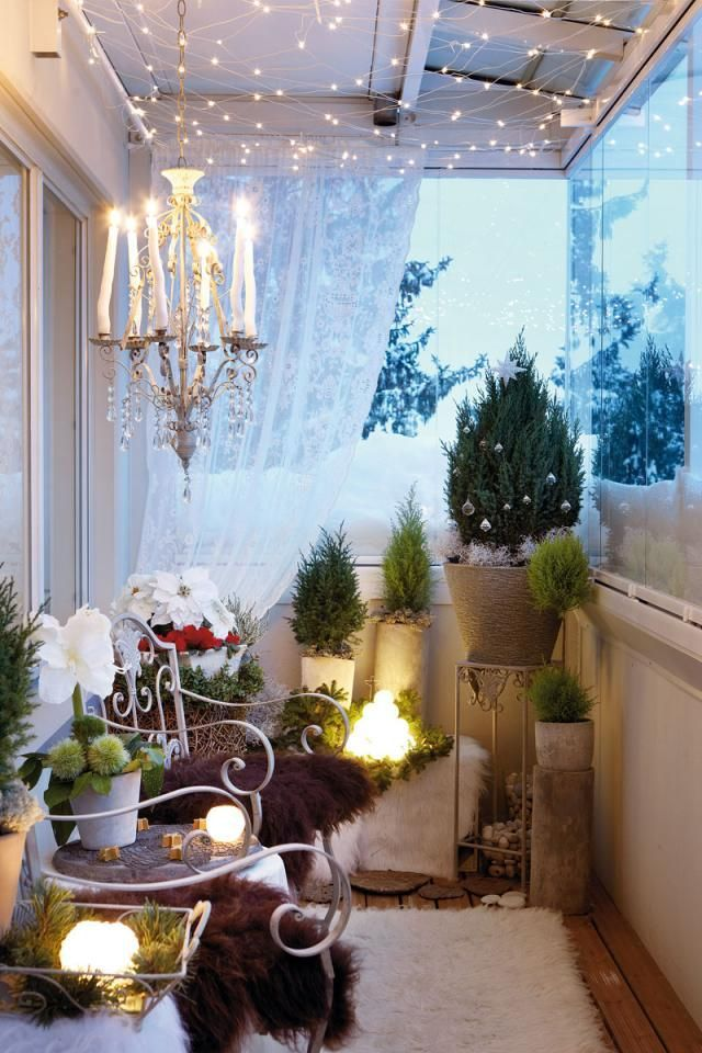 if you have a cozy and covered balcony decorate with tiny christmas tree you can even enhance the decoration with a candle chandelier - Cool Christmas Decoration Ideas