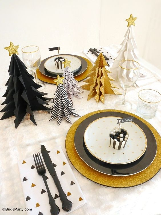 black and gold christmas tablescape source