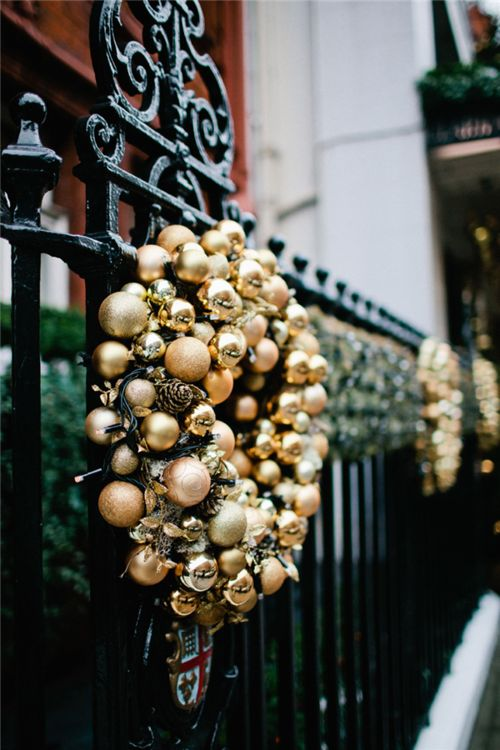 gold wreath against black background source - Black And Gold Christmas Decorations
