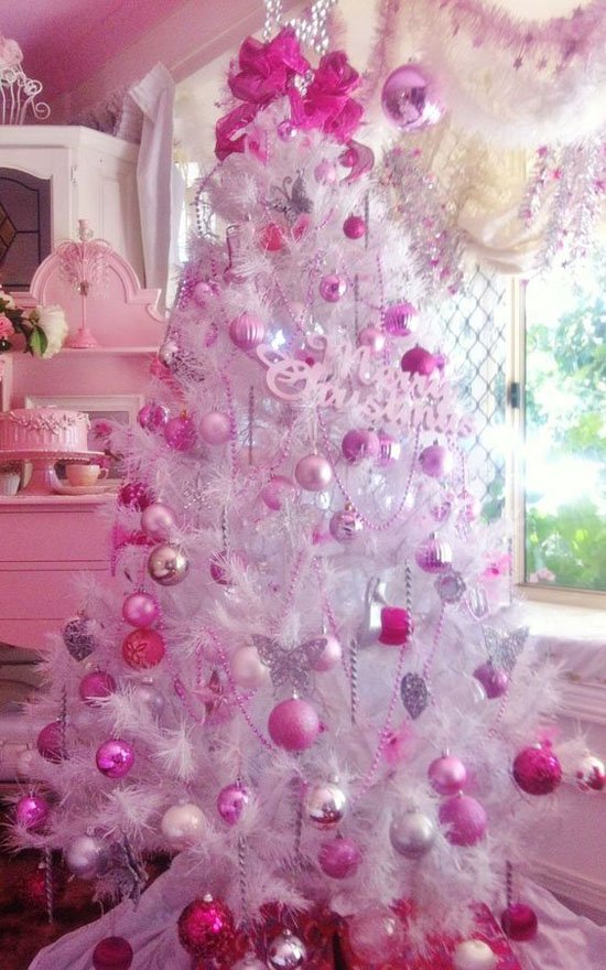 what a better way of turning a white tree into something pinkish other than adding pink ornaments and decorations on them