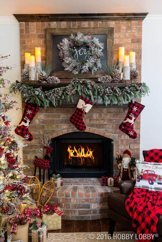 This is probably one of the most beautifully decorated mantels that I've seen. The plaids, greens and pinecone made this decoration idea a luxurious one.