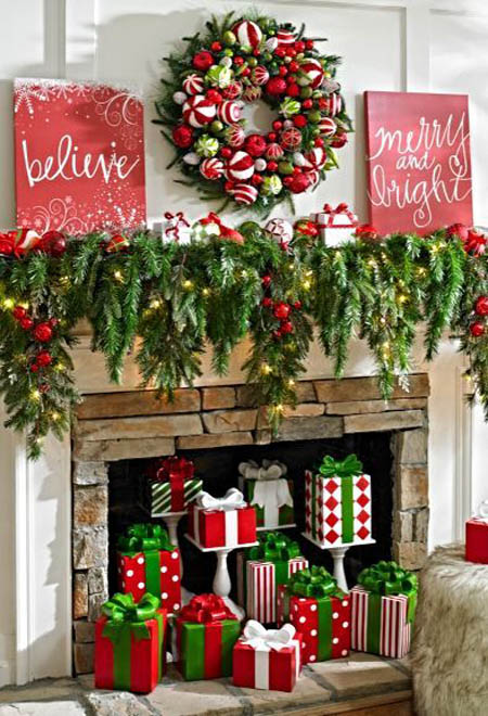 try filling up the mantel with garlands and throw some classic red and silver ornaments to it