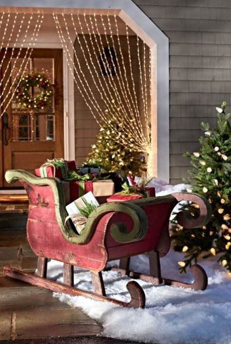 who wouldnt love to this decorating idea which incorporating a giant wooden sleigh it is a perfect place to set up those gifts added with faux snow