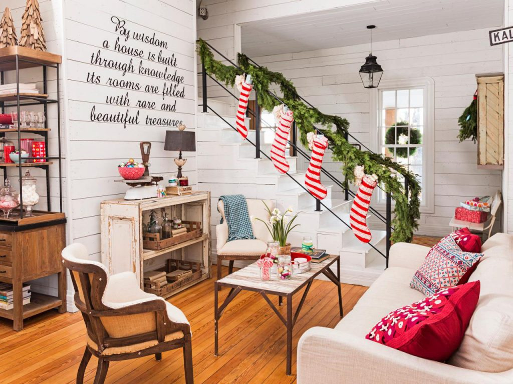 While the entire setting in this picture is thoroughly modern, right from  the pillow covers to banister garlands, the shelf beneath the staircase is  giving ...