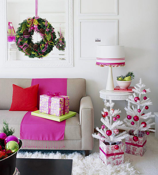 Replace traditional red and green with pops of pink to create a contemporary  Christmas dcor. The white miniature Christmas trees, decked with pink are  ...