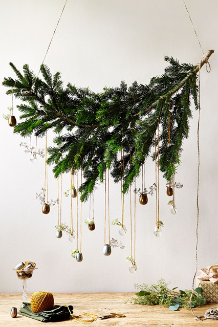 this simple christmas hanging decoration idea is perfect for above a console table or a smaller space you just need to tie a string from the ends of the - Christmas Hanging Decorations