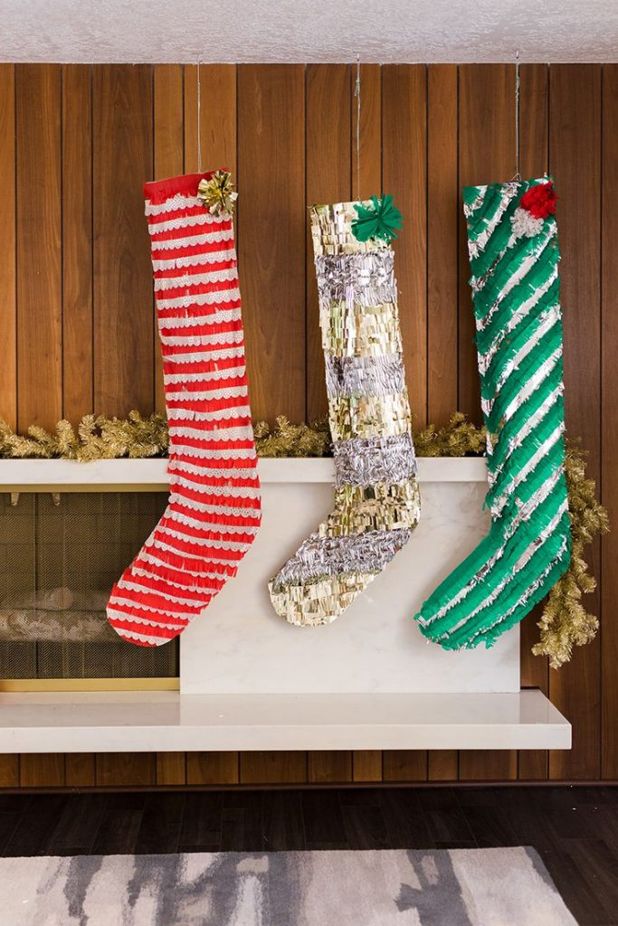 these oversized stockings made with paper will beautify your indoor decoration if you want to irk children a bit place the little gifts in them