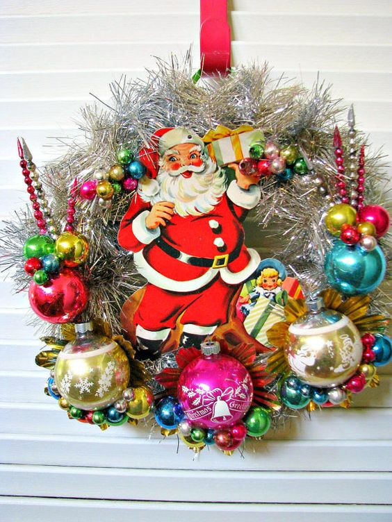just give some glances at this kitsch christmas wreath wrapped in silver tinsel this wreath is decorated with mercury glass and vintage ornaments