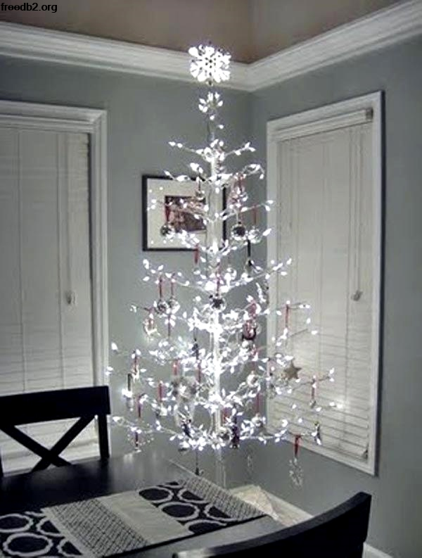 heres another contemporary christmas tree idea a sparkling christmas tree with very minimal ornaments and decorations this is for those who dont like