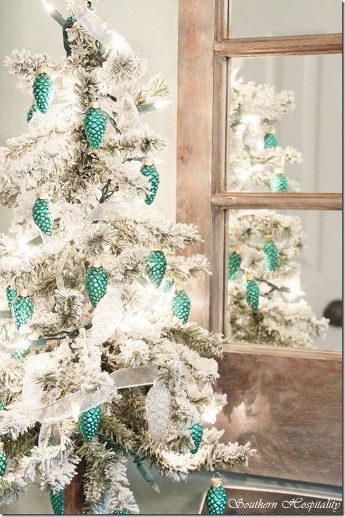 a combination of white and teal looks absolutely amazing as exemplified in this picture while the blogger has hung teal ornaments on the tree